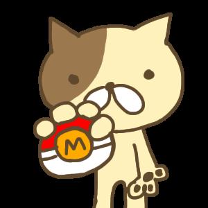 モンスターボールを持つ茶色い猫